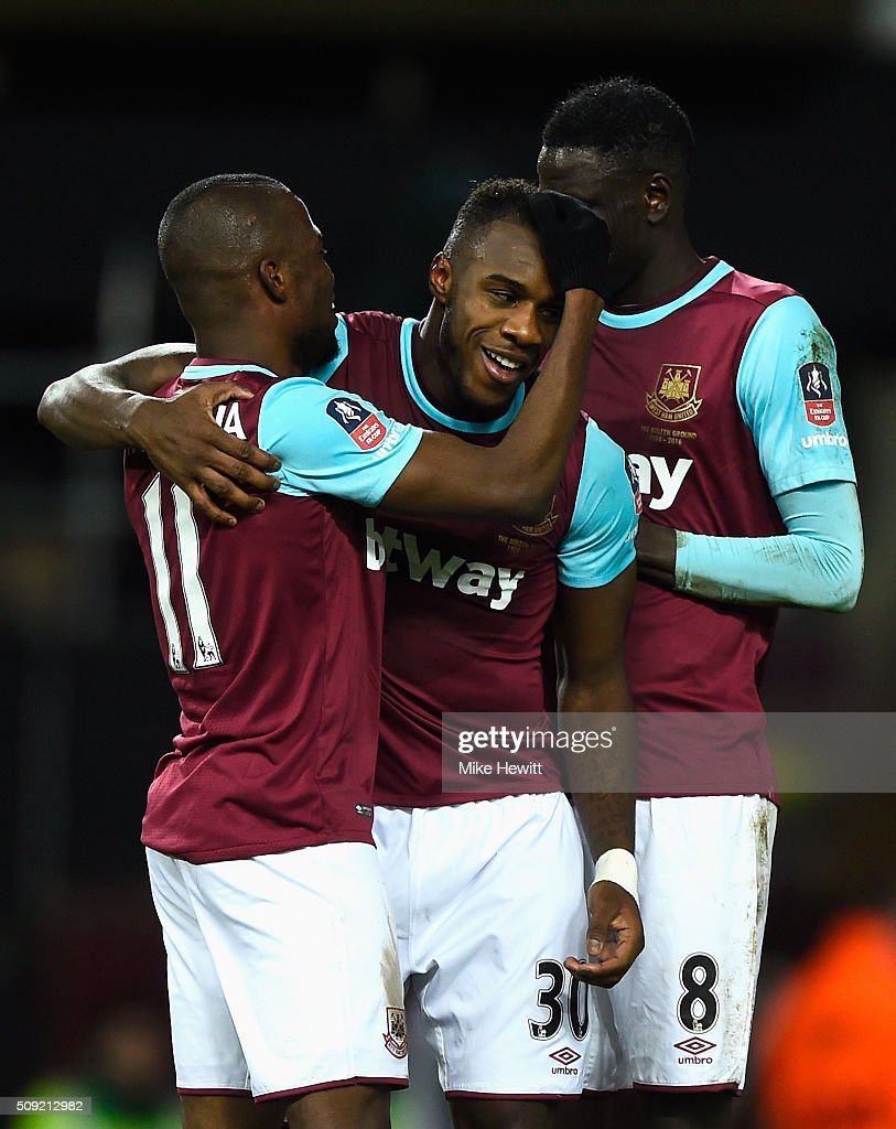 <a gi-track='captionPersonalityLinkClicked' href=/galleries/search?phrase=Michail+Antonio&family=editorial&specificpeople=5806303 ng-click='$event.stopPropagation()'>Michail Antonio</a> of West Ham United (C) celebrates with team mates <a gi-track='captionPersonalityLinkClicked' href=/galleries/search?phrase=Enner+Valencia&family=editorial&specificpeople=6898122 ng-click='$event.stopPropagation()'>Enner Valencia</a> (11) and Cheikhou Kouyate (8) as he scores their first goal during the Emirates FA Cup Fourth Round Replay match between West Ham United and Liverpool at Boleyn Ground on February 9, 2016 in London, England.