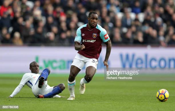 Michail Antonio of West Ham United escapes the challenge of N'Golo Kante of Chelsea during the Premier League match between West Ham United and...