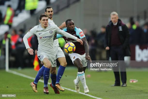 Michail Antonio of West Ham United is challenged by Andreas Christensen of Chelsea during the Premier League match between West Ham United and...