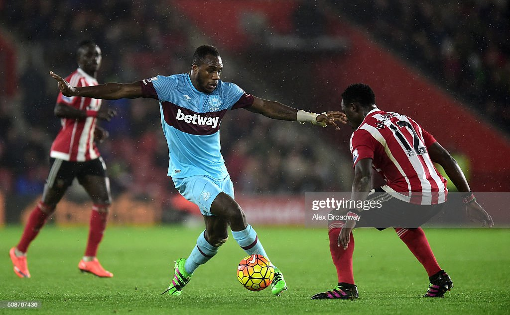 Michail Antonio of West Ham United is faced by Victor Wanyama of Southampton during the Barclays Premier League match between Southampton and West Ham United at St Mary's Stadium on February 6, 2016 in Southampton, England.