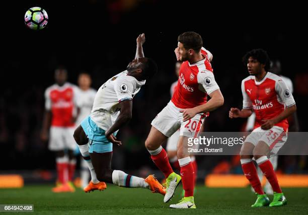 Michail Antonio of West Ham United is fouled by Shkodran Mustafi of Arsenal during the Premier League match between Arsenal and West Ham United at...