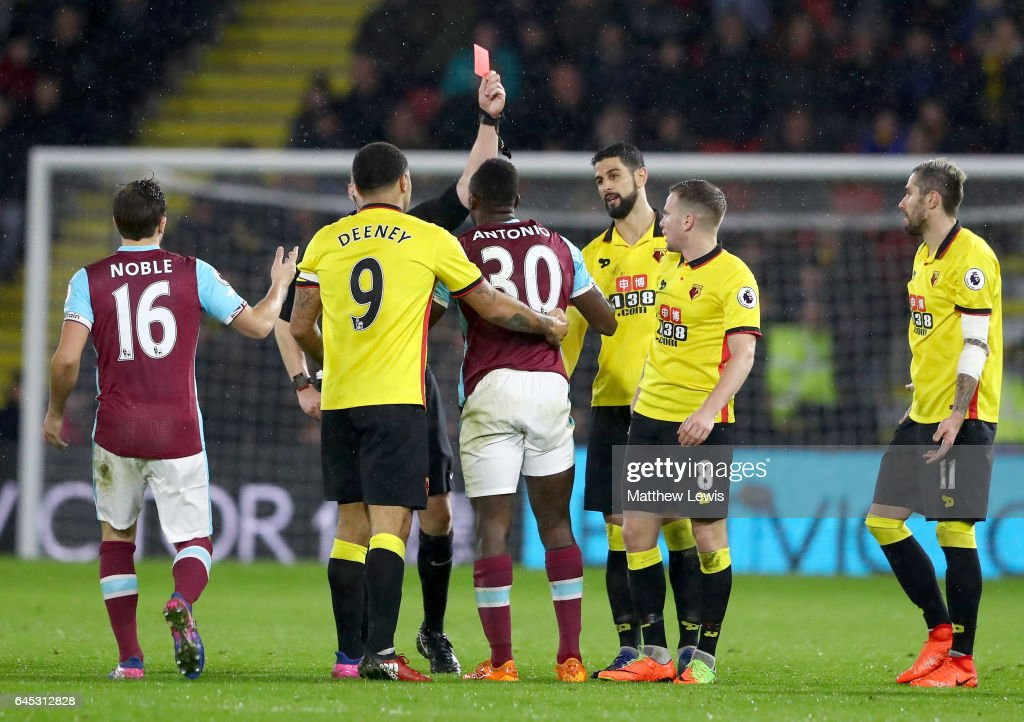 Michail Antonio of West Ham United is shown a red card during the Premier League match between Watford and West Ham United at Vicarage Road on February 25, 2017 in Watford, England.