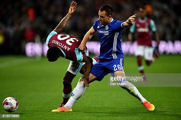 Michail Antonio of West Ham United is tackled by John Terry of Chelsea during the EFL Cup fourth round match between West Ham United and Chelsea at...