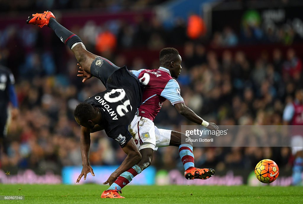 <a gi-track='captionPersonalityLinkClicked' href=/galleries/search?phrase=Michail+Antonio&family=editorial&specificpeople=5806303 ng-click='$event.stopPropagation()'>Michail Antonio</a> of West Ham United is upended by <a gi-track='captionPersonalityLinkClicked' href=/galleries/search?phrase=Idrissa+Gueye&family=editorial&specificpeople=7312174 ng-click='$event.stopPropagation()'>Idrissa Gueye</a> of Aston Villa during the Barclays Premier League match between Aston Villa and West Ham United at Villa Park on December 26, 2015 in Birmingham, England.