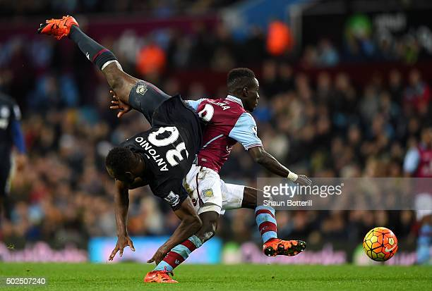 Michail Antonio of West Ham United is upended by Idrissa Gueye of Aston Villa during the Barclays Premier League match between Aston Villa and West...