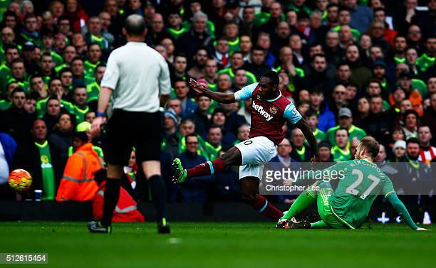 Michail Antonio of West Ham United scores his team's first goal during the Barclays Premier League match between West Ham United and Sunderland at...