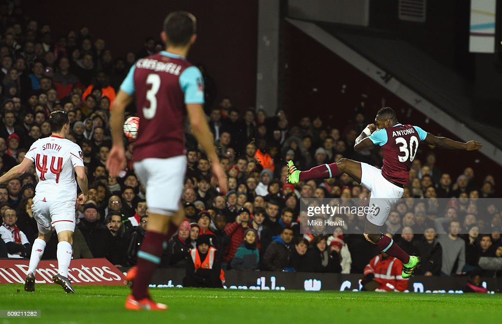 <a gi-track='captionPersonalityLinkClicked' href=/galleries/search?phrase=Michail+Antonio&family=editorial&specificpeople=5806303 ng-click='$event.stopPropagation()'>Michail Antonio</a> of West Ham United scores the opening goal during the Emirates FA Cup Fourth Round Replay match between West Ham United and Liverpool at Boleyn Ground on February 9, 2016 in London, England.