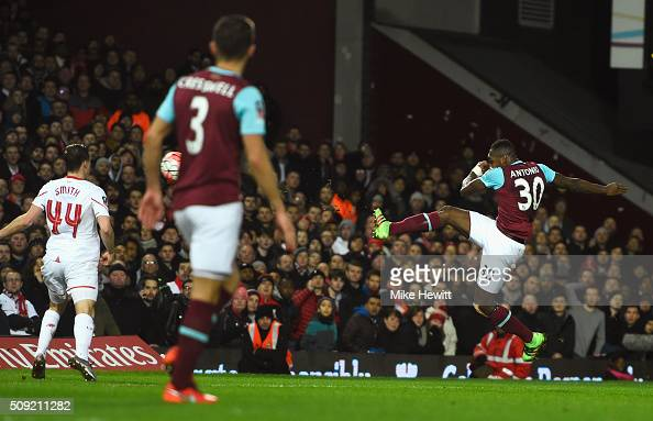 Michail Antonio of West Ham United scores the opening goal during the Emirates FA Cup Fourth Round Replay match between West Ham United and Liverpool...
