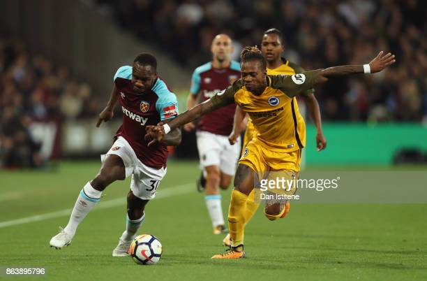 Michail Antonio of West Ham United takes on Gaetan Bong of Brighton and Hove Albion during the Premier League match between West Ham United and...