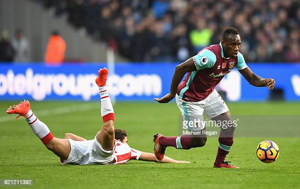 Michail Antonio of West Ham United takes the ball past Ramadan Sobhi of Stoke City during the Premier League match between West Ham United and Stoke...