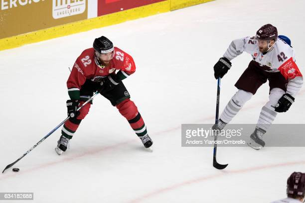 Michal Barinka of the Sparta Prague defends against Robin Figren of the Frolunda Gothenburg during the Champions Hockey League Final between Frolunda...