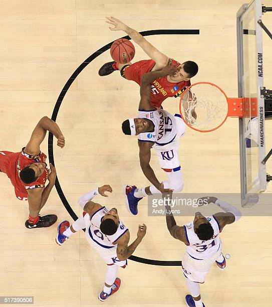 Michal Cekovsky of the Maryland Terrapins defends a shot by Carlton Bragg Jr #15 of the Kansas Jayhawks during the 2016 NCAA Men's Basketball...