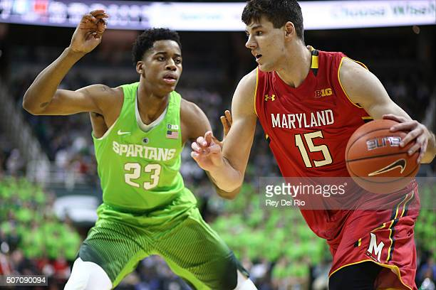 Michal Cekovsky of the Maryland Terrapins drives pass Deyonta Davis of the Michigan State Spartans in the first half at the Breslin Center on January...