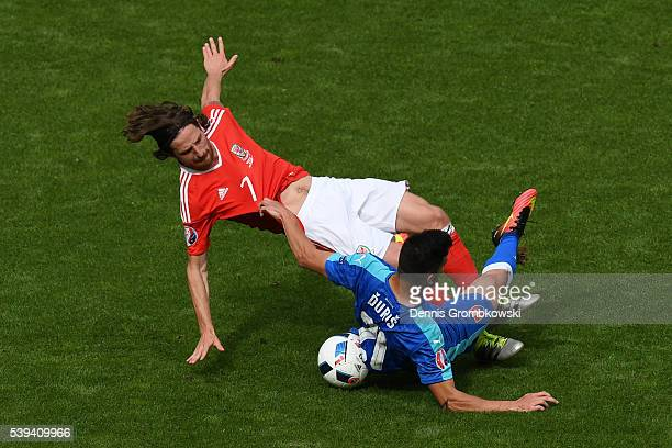 Michal Duris of Slovakia and Joe Allen of Wales compete for the ball during the UEFA EURO 2016 Group B match between Wales and Slovakia at Stade...