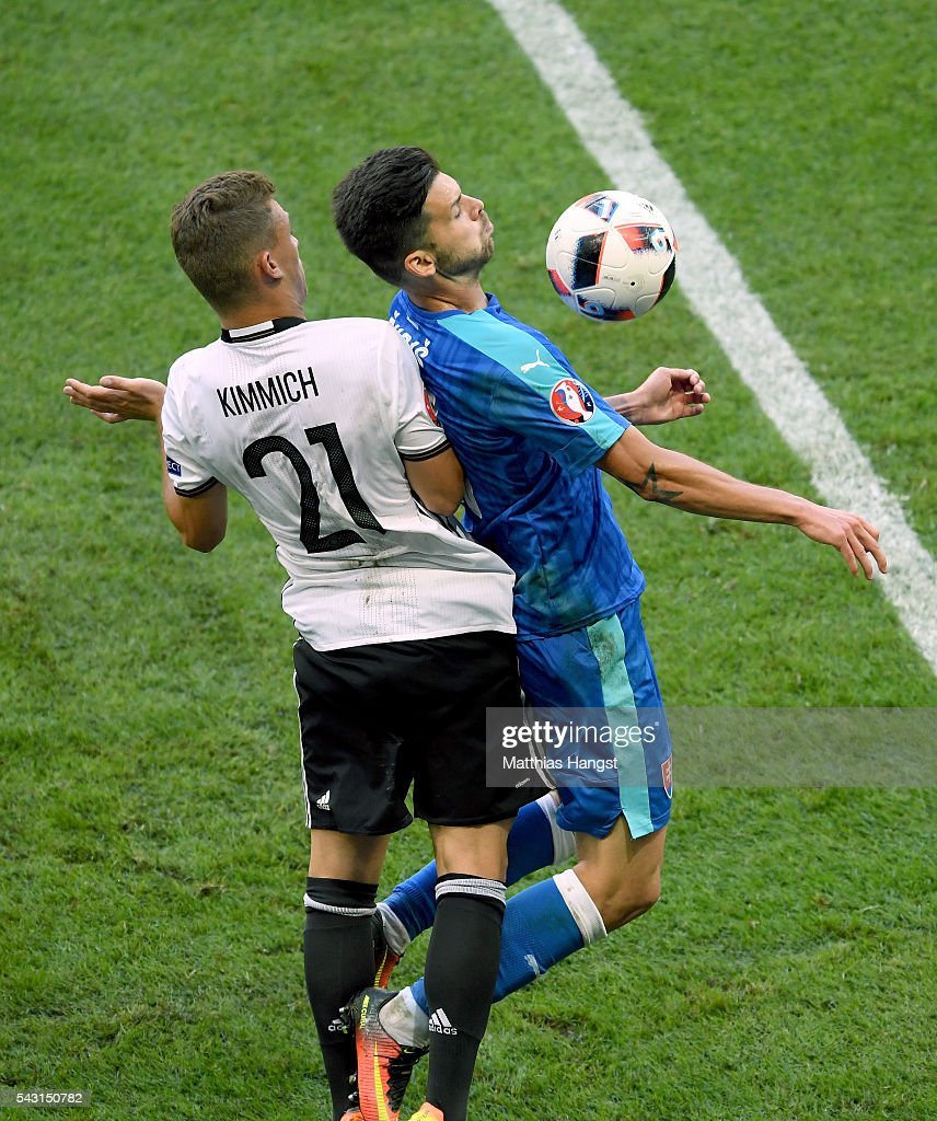 Michal Duris of Slovakia and <a gi-track='captionPersonalityLinkClicked' href=/galleries/search?phrase=Joshua+Kimmich&family=editorial&specificpeople=9479434 ng-click='$event.stopPropagation()'>Joshua Kimmich</a> of Germany compete for the ball during the UEFA EURO 2016 round of 16 match between Germany and Slovakia at Stade Pierre-Mauroy on June 26, 2016 in Lille, France.