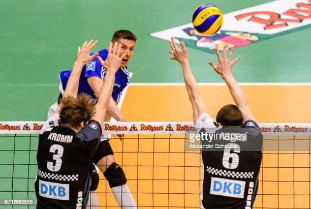 Michal Finger of Friedrichshafen in action against Robert Kromm of Berlin and Felix Fischer of Berlin during the Volleyball final playoffs match 1...