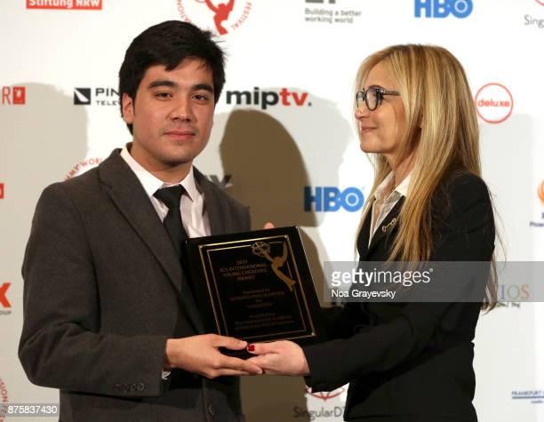 Michal Grayevsky President JCS International presents an award to finalist Roberto Pino Almeyda during the Nominee Medal Ceremony JCSI Young...