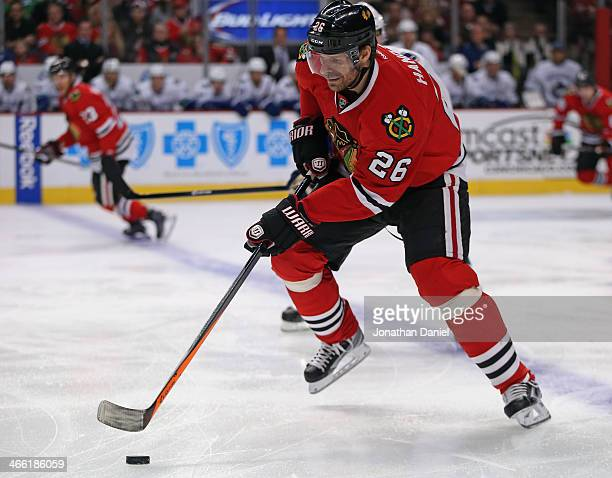Michal Handzue of the Chicago Blackhawks moves against the Vancouver Canucks at the United Center on December 20 2013 in Chicago Illinois The Canucks...