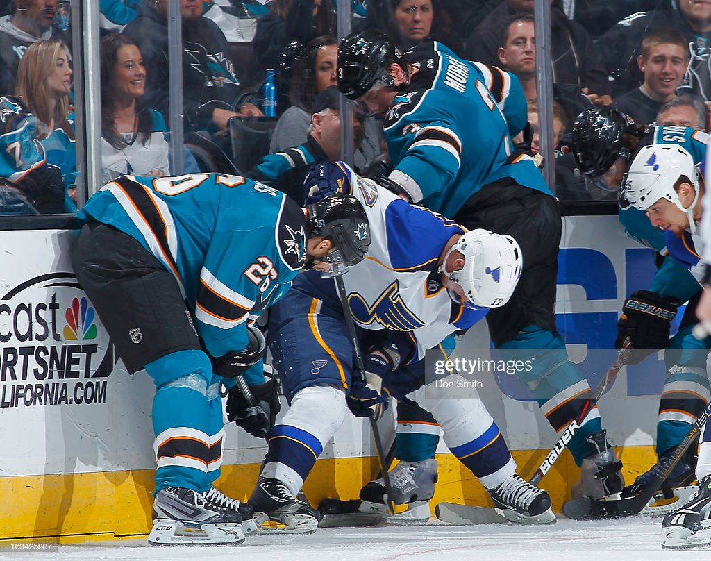 Michal Handzus #26 and Douglas Murray #3 of the San Jose Sharks battle for the puck against Vladimir Sobotka #17 of the St. Louis Blues during an NHL game on March 9, 2013 at HP Pavilion in San Jose, California.