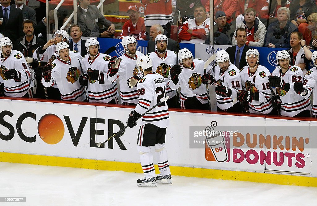 Michal Handzus #26 of the Chicago Blackhawks celebrates his third period goal with teammates on the bench while playing the Detroit Red Wings in Game Six of the Western Conference Semifinals during the 2013 NHL Stanley Cup Playoffs at Joe Louis Arena on May 27, 2013 in Detroit, Michigan.