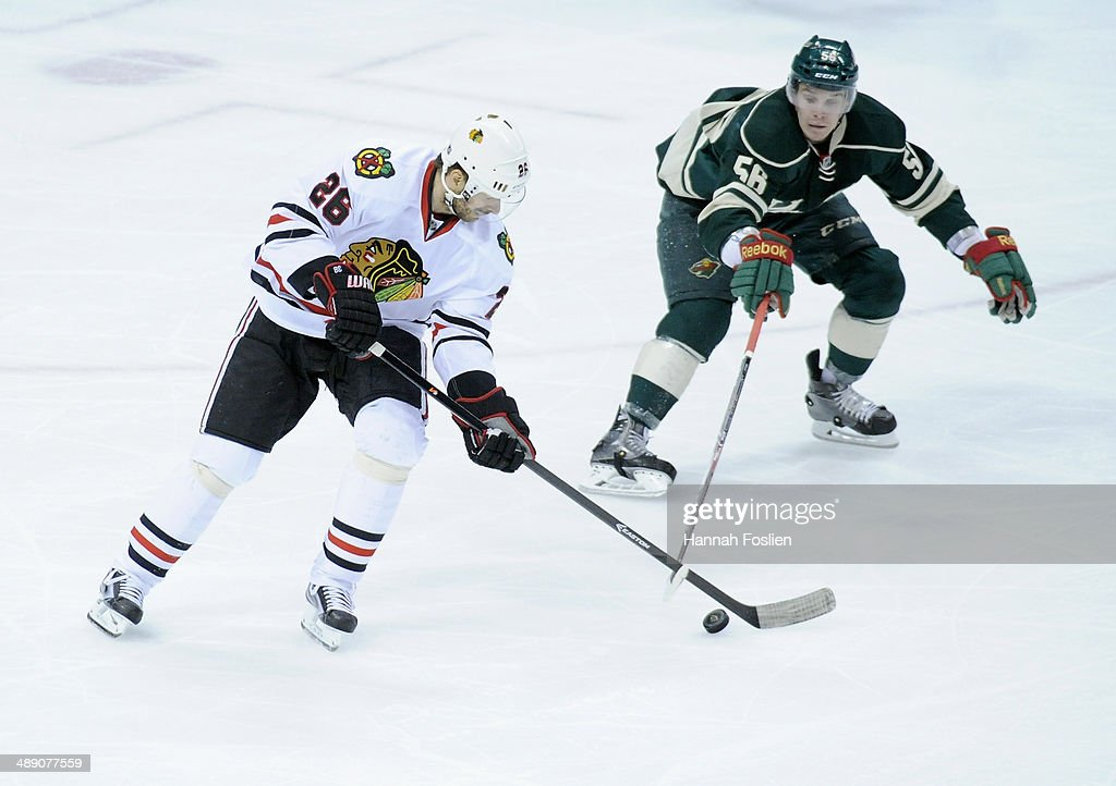 Michal Handzus #26 of the Chicago Blackhawks controls the puck against Erik Haula #56 of the Minnesota Wild during the first period in Game Four of the Second Round of the 2014 NHL Stanley Cup Playoffs on May 9, 2014 at Xcel Energy Center in St Paul, Minnesota. The Wild defeated the Blackhawks 4-2.