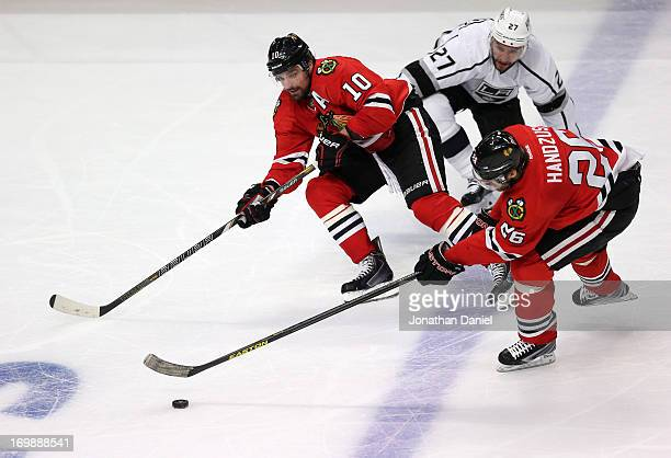 Michal Handzus of the Chicago Blackhawks controls the puck over the Kings blueline on the two on one with teammate Patrick Sharp against Alec...