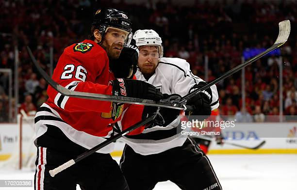 Michal Handzus of the Chicago Blackhawks fights for position against Trevor Lewis of the Los Angeles Kings during Game Five of the Western Conference...