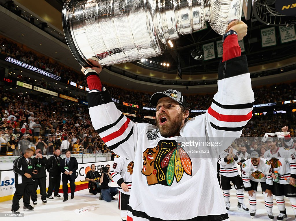 Michal Handzus #26 of the Chicago Blackhawks hoists the Stanley Cup after his team defeated the Boston Bruins 3-2 in Game Six of the 2013 Stanley Cup Final at TD Garden on June 24, 2013 in Boston, Massachusetts. The Chicago Blackhawks won the series 4-2 to win the Stanley Cup.