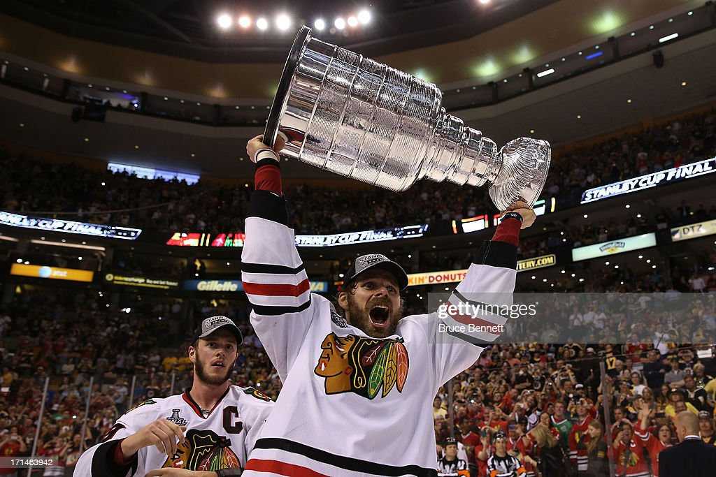 Michal Handzus #26 of the Chicago Blackhawks hoists the Stanley Cup Trophy after defeating the Boston Bruins in Game Six of the 2013 NHL Stanley Cup Final at TD Garden on June 24, 2013 in Boston, Massachusetts. The Chicago Blackhawks defeated the Boston Bruins 3-2.