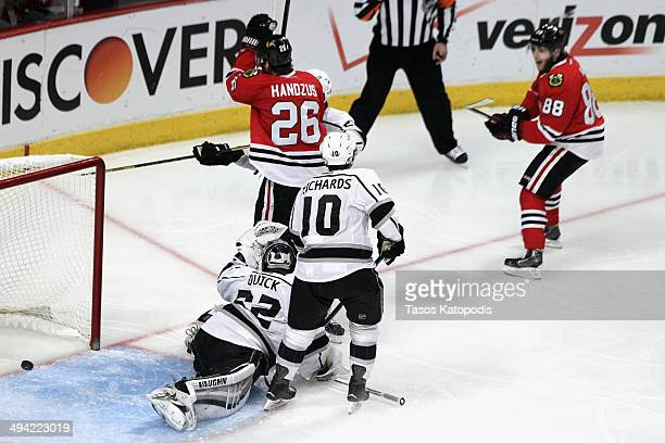 Michal Handzus of the Chicago Blackhawks scores a goal against Jonathan Quick of the Los Angeles Kings in double overtime to win Game Five of the...