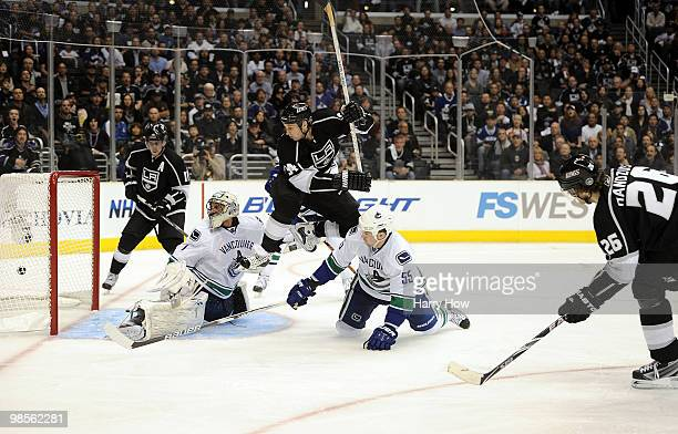 Michal Handzus of the Los Angeles Kings scores a goal past Roberto Luongo of the Vancouver Canucks as Ryan Smyth of the Los Angeles Kings and Shane...
