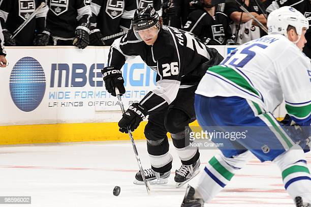 Michal Handzus of the Los Angeles Kings skates with the puck against the Vancouver Canucks in Game Three of the Western Conference Quarterfinals...