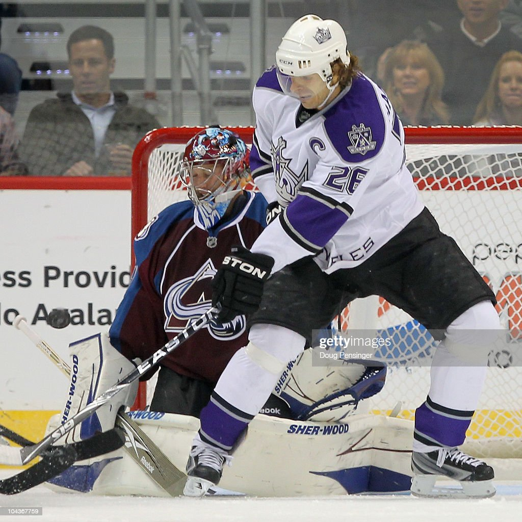 Michal Handzus #26 of the Los Angeles Kings tries to redirect a shot past goalie <a gi-track='captionPersonalityLinkClicked' href=/galleries/search?phrase=Craig+Anderson&family=editorial&specificpeople=211238 ng-click='$event.stopPropagation()'>Craig Anderson</a> #41 of the Colorado Avalanche during preseason NHL action at the Pepsi Center on September 22, 2010 in Denver, Colorado.