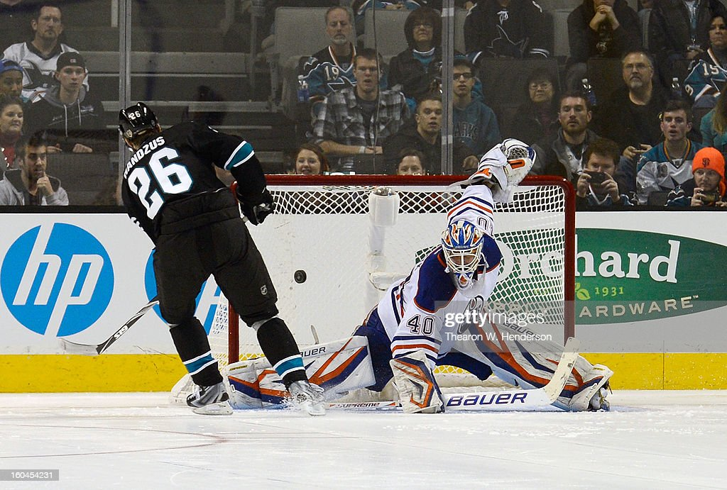 Michal Handzus #26 of the San Jose Sharks gets his shot by Goalkeeper Devan Dubnyk #40 of the Edmonton Oilers for the first score of an over time shoot-out at HP Pavilion on January 31, 2013 in San Jose, California. The Sharks won the game 3-2 in the overtime shoot-out.