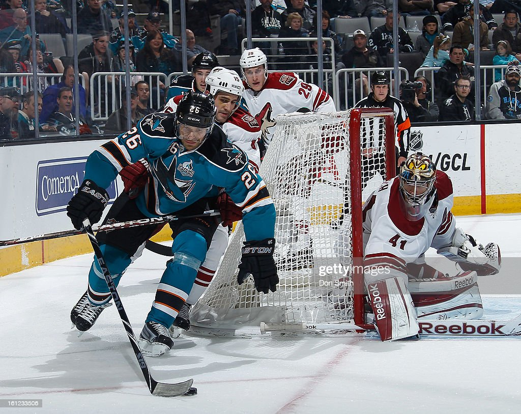 Michal Handzus #26 of the San Jose Sharks skates the puck around the net against Mike Smith #41, Boyd Gordon #15 and Michael Stone #29 of the Phoenix Coyotes during an NHL game on February 9, 2013 at HP Pavilion in San Jose, California.