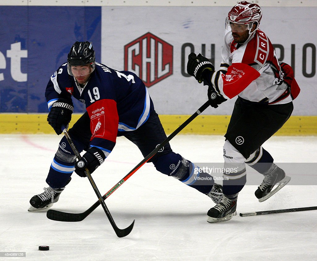 Michal Hlinka of Vitkovice Ostrava handles the puck under pressure during the Champions Hockey League group stage game between Vitkovice Ostrave and EV Zug on August 23, 2014 in Ostrava, Czech Republic.