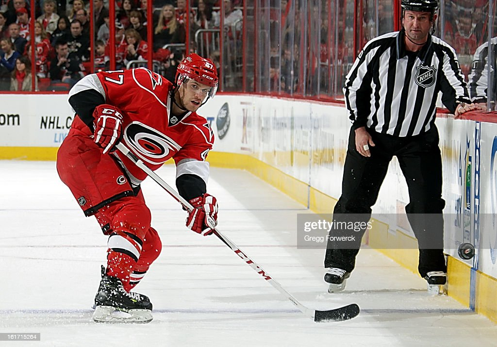 Michal Jordan #47 of the Carolina Hurricanes dumps the puck in from the blue line during an NHL game against the Toronto Maple Leafs at PNC Arena on February 14, 2013 in Raleigh, North Carolina. Jordan has been recalled from the Charlotte Checkers and is making his NHL debut tonight.