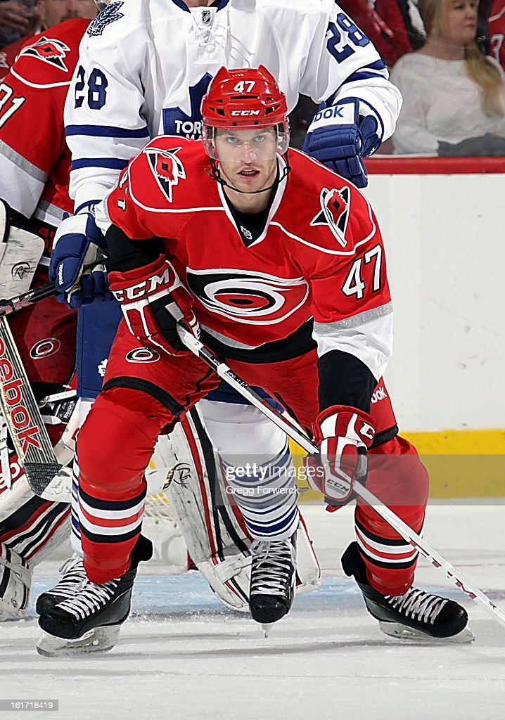 Michal Jordan #47 of the Carolina Hurricanes keeps his focus on the puck during an NHL game against the Toronto Maple Leafs at PNC Arena on February 14, 2013 in Raleigh, North Carolina. Jordan has been recalled from the Charlotte Checkers and is making his NHL debut tonight.