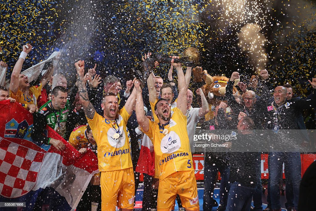 <a gi-track='captionPersonalityLinkClicked' href=/galleries/search?phrase=Michal+Jurecki&family=editorial&specificpeople=4116955 ng-click='$event.stopPropagation()'>Michal Jurecki</a> of Kielce (R) and <a gi-track='captionPersonalityLinkClicked' href=/galleries/search?phrase=Grzegorz+Tkaczyk&family=editorial&specificpeople=2115247 ng-click='$event.stopPropagation()'>Grzegorz Tkaczyk</a> celebrate after winning the EHF Champions League Final against MKB Veszprem on May 29, 2016 in Cologne, Germany.