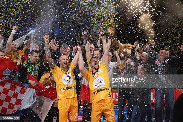 Michal Jurecki of Kielce and Grzegorz Tkaczyk celebrate after winning the EHF Champions League Final against MKB Veszprem on May 29 2016 in Cologne...