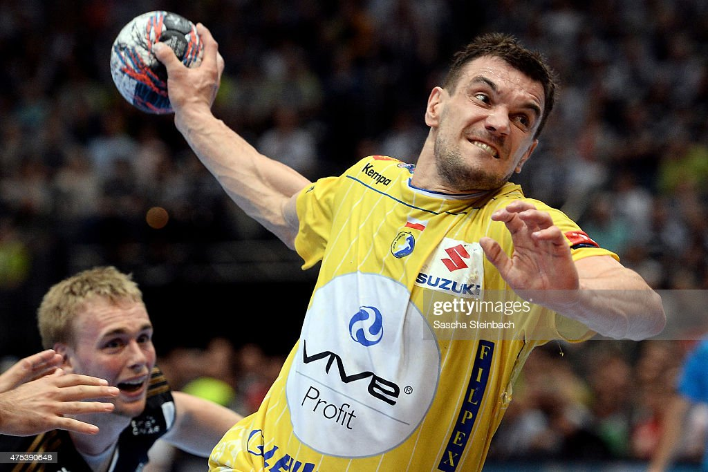 <a gi-track='captionPersonalityLinkClicked' href=/galleries/search?phrase=Michal+Jurecki&family=editorial&specificpeople=4116955 ng-click='$event.stopPropagation()'>Michal Jurecki</a> of Kielce throws the ball during the 'VELUX EHF FINAL4' semi final match between THW Kiel and KS Vive Tauron Kielce at Lanxess Arena on May 31, 2015 in Cologne, Germany.