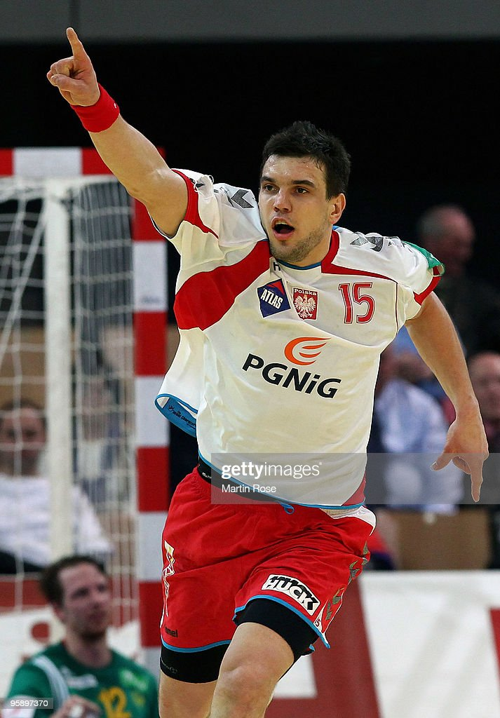<a gi-track='captionPersonalityLinkClicked' href=/galleries/search?phrase=Michal+Jurecki&family=editorial&specificpeople=4116955 ng-click='$event.stopPropagation()'>Michal Jurecki</a> of Poland celebrates during the Men's Handball European Championship Group C match between Poland and Sweden at the Olympia Hall on January 20, 2009 in Innsbruck, Austria.