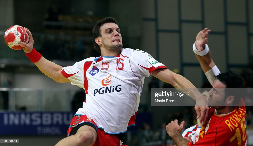<a gi-track='captionPersonalityLinkClicked' href=/galleries/search?phrase=Michal+Jurecki&family=editorial&specificpeople=4116955 ng-click='$event.stopPropagation()'>Michal Jurecki</a> (L) of Poland in action with <a gi-track='captionPersonalityLinkClicked' href=/galleries/search?phrase=Iker+Romero&family=editorial&specificpeople=853946 ng-click='$event.stopPropagation()'>Iker Romero</a> (R) of Spain during the Men's Handball European main round Group II match between Poland and Spain at the Olympia Hall on January 24, 2009 in Innsbruck, Austria.