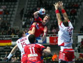 Michal Jurecki of Poland tackles Momir Ilic of Serbia during the Men's World Handball Championships main round match group two between Serbia and...