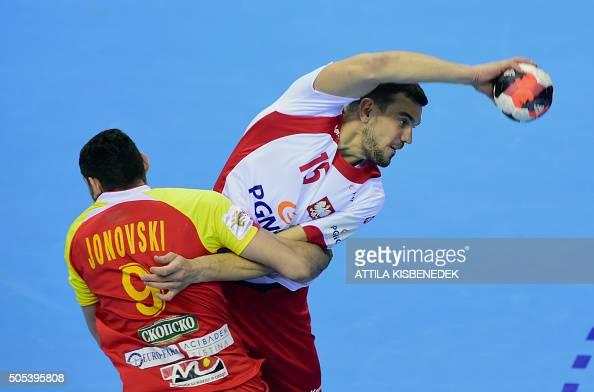 TOPSHOT Michal Jurecki of Poland vies for the ball with Aco Jonovski of Macedonia during the Men's 2016 EHF European Handball Championships match...