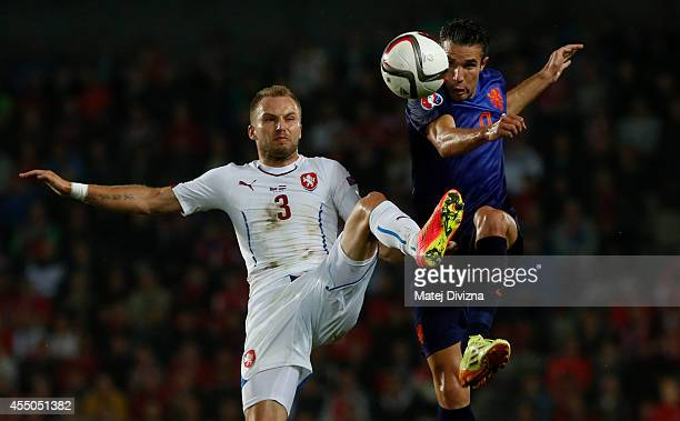 Michal Kadlec of Czech Republic competes for the ball with Robin van Persie of Netherlands during the UEFA EURO 2016 Group A Qualifier between Czech...
