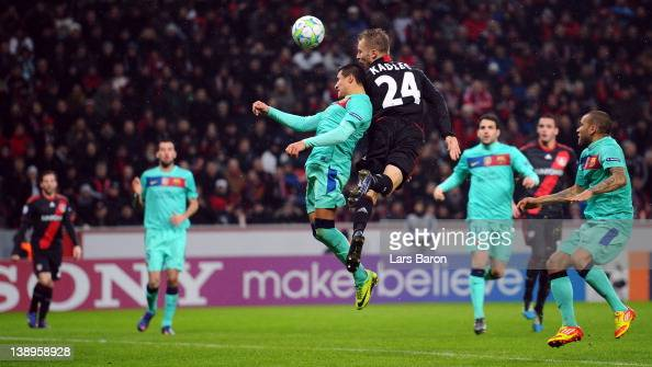 Michal Kadlec of Leverkusen heads his teams first goal during the UEFA Champions League round of 16 first leg match between Bayer 04 Leverkusen and...