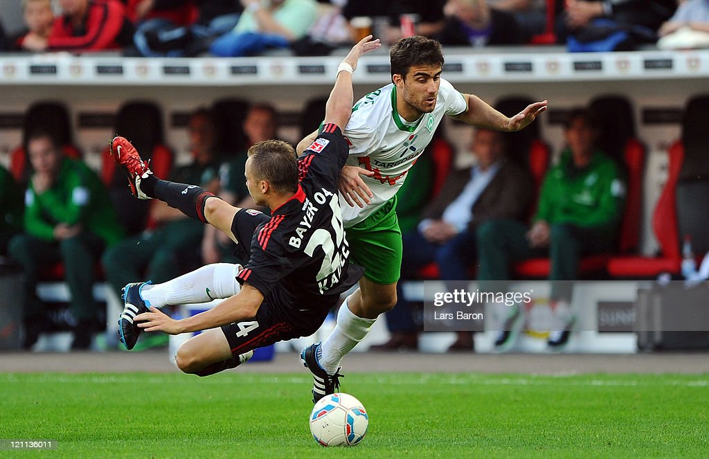 <a gi-track='captionPersonalityLinkClicked' href=/galleries/search?phrase=Michal+Kadlec&family=editorial&specificpeople=2156641 ng-click='$event.stopPropagation()'>Michal Kadlec</a> of Leverkusen is challenged by Sokratis of Bremen during the Bundesliga match between Bayer 04 Leverkusen and SV Werder Bremen at BayArena on August 14, 2011 in Leverkusen, Germany.