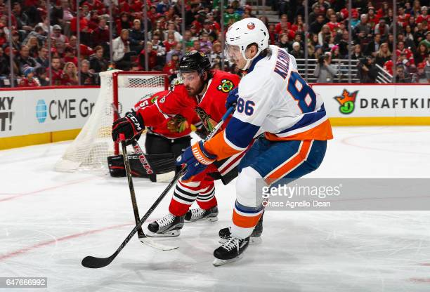 Michal Kempny of the Chicago Blackhawks and Nikolay Kulemin of the New York Islanders skate in the third period at the United Center on March 3 2017...
