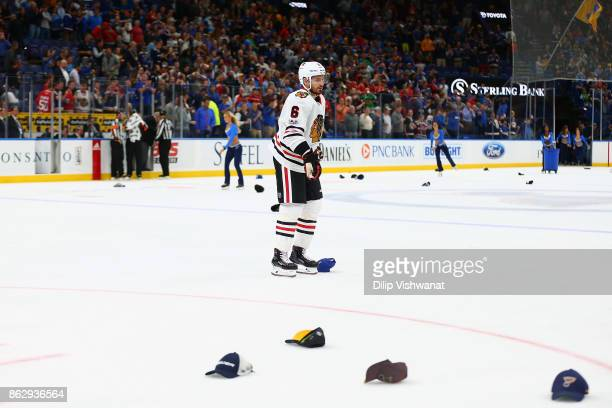 Michal Kempny of the Chicago Blackhawks leave the ice after Jaden Schwartz of the St Louis Blues competed a hat trick with an emptynet goal against...